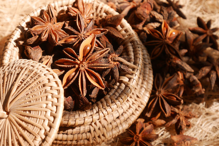 High angle view of star anise in wicker basket
