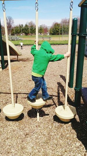 Life is a balancing act. Full Length Playground One Person Childhood Outdoor Play Equipment Child Day Boys Children Only Outdoors People Real People Sky One Boy Only Adult