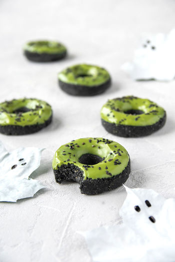 Matcha-Charcoal Halloween Donuts (vegan) Food Healthy Eating Close-up Still Life Table Matcha Donut Donuts Halloween Foodporn Foodphotography Decoration Stack Charcoal Vegan Raw Baking Recipe
