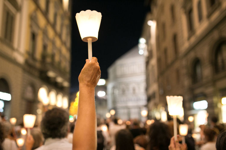 View of person holding candle at night