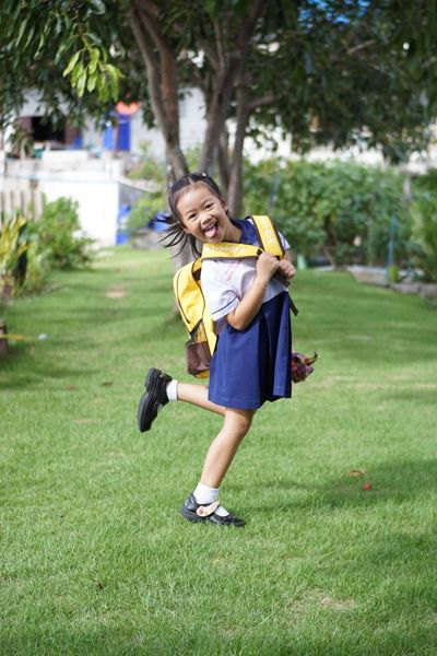 Khwan Khaw after school. Student Thai Thailand After School Child Childhood Day Emotion Females Front View Full Length Girl Girls Grass Hairstyle Happiness Innocence Kid Leisure Activity Looking At Camera One Person Outdoors Plant Portrait Running Smiling Student Uniform Unifrom Women Young Adult The Portraitist - 2018 EyeEm Awards The Fashion Photographer - 2018 EyeEm Awards The Still Life Photographer - 2018 EyeEm Awards
