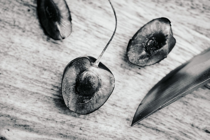 Some Cherries Close-up Directly Above Eating Utensil Focus On Foreground Food Food And Drink Freshness Fruit Healthy Eating High Angle View Indoors  Metal No People Plant Spoon Still Life Table Vegetable Wellbeing Wood - Material