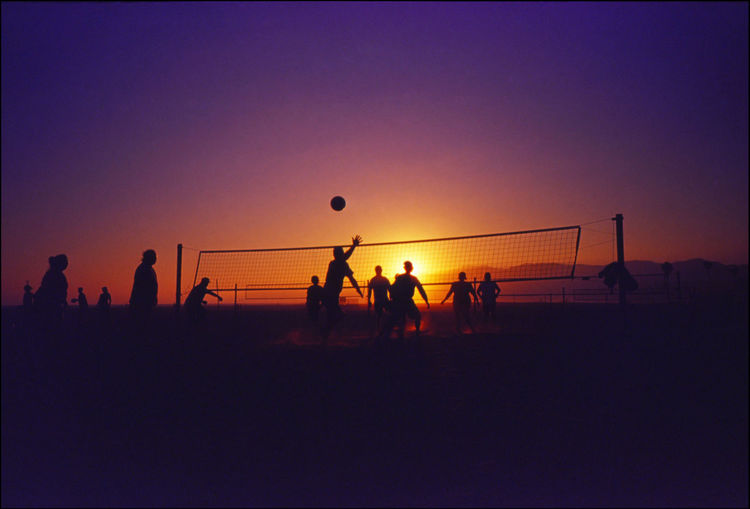 Silhouette People Playing Volleyball Against Clear Sky During Sunset