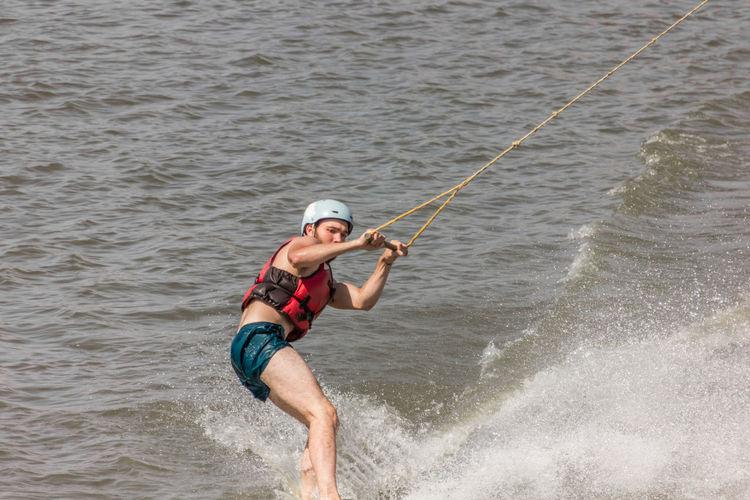 Man kite boarding in river