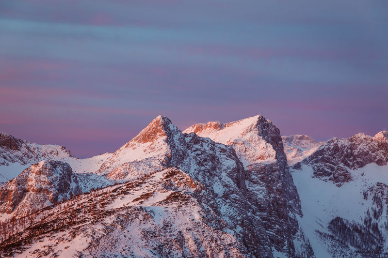 Scenic view of snowcapped mountains against sky during winter