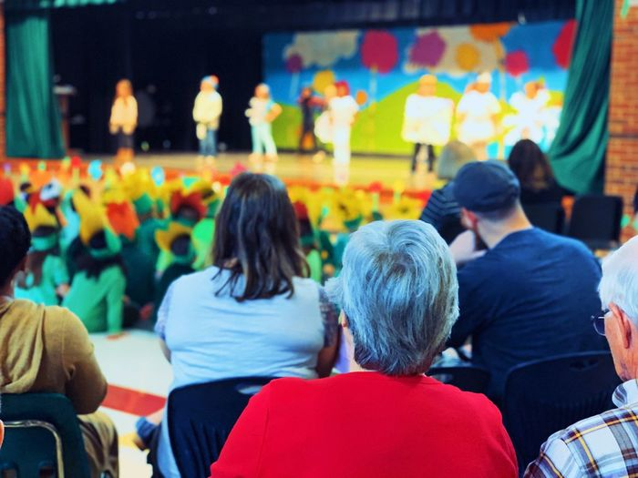 School event and kids performance at school cultural function Group Of People Rear View Adult Women Sitting People Men Sport Spectator Lifestyles Indoors  Casual Clothing Watching Education Crowd Leisure Activity Real People Togetherness Emotion