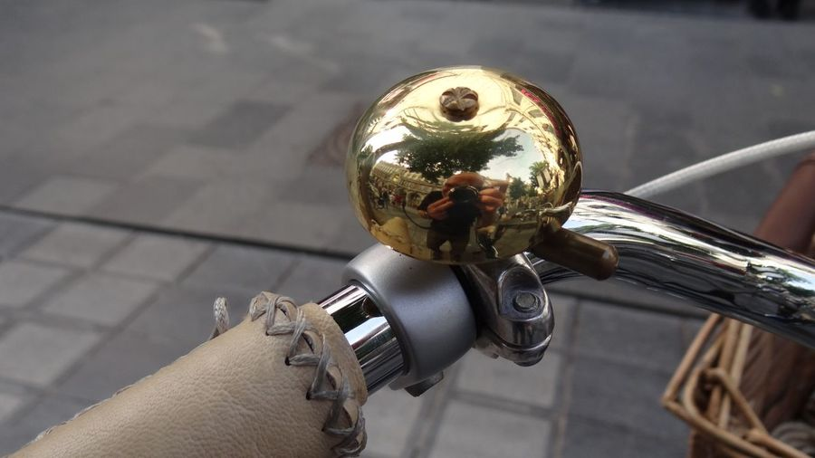 Reflection Of Man Photographing On Bicycle Bell