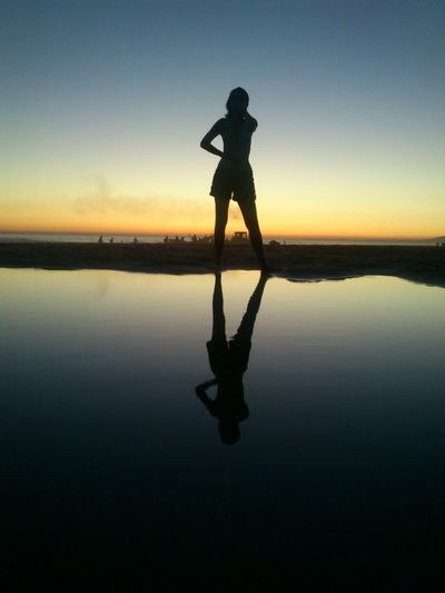 Rear view of silhouette woman with reflection