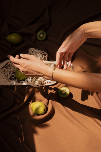 High angle view of hand holding fruit