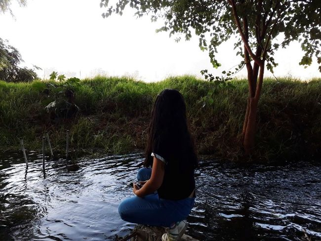 Nature Women Full Length Outdoors Day One Person One Woman Only Water Adults Only Young Women