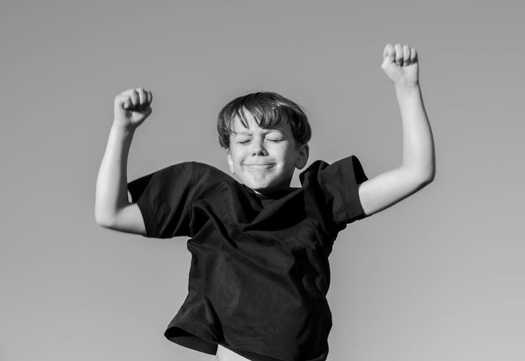 Portrait of boy jumping against white background