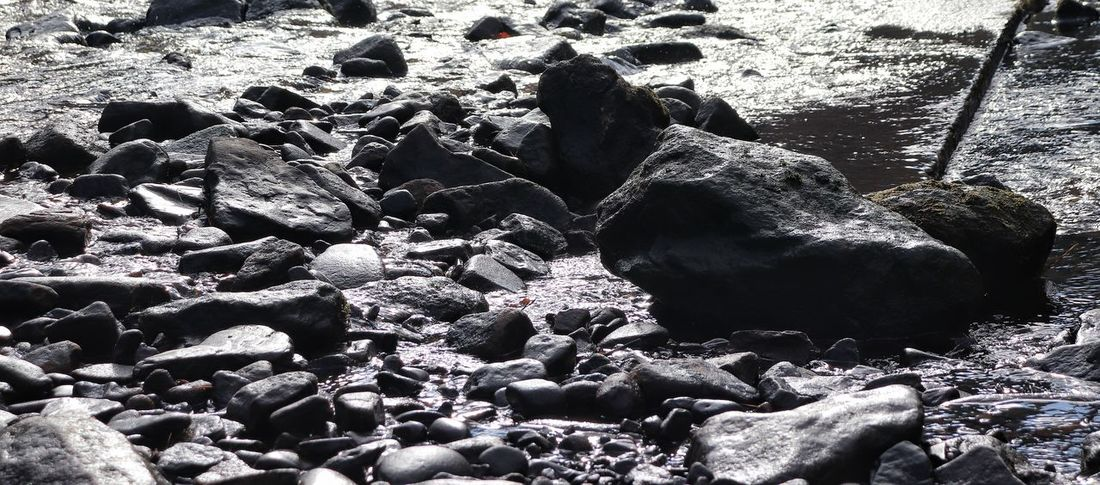 River Rock Rocks Rocks And Water Beach Shadow Backgrounds Full Frame Sunlight High Angle View Sand Close-up