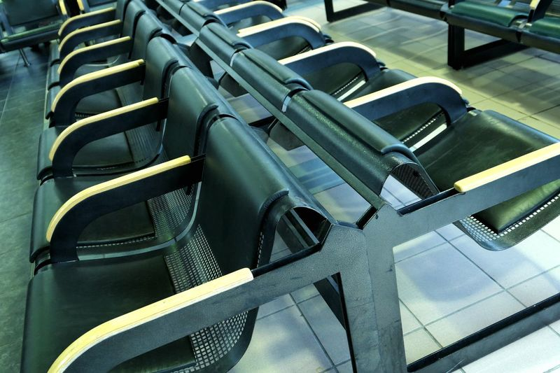 High angle view of empty chairs in waiting room