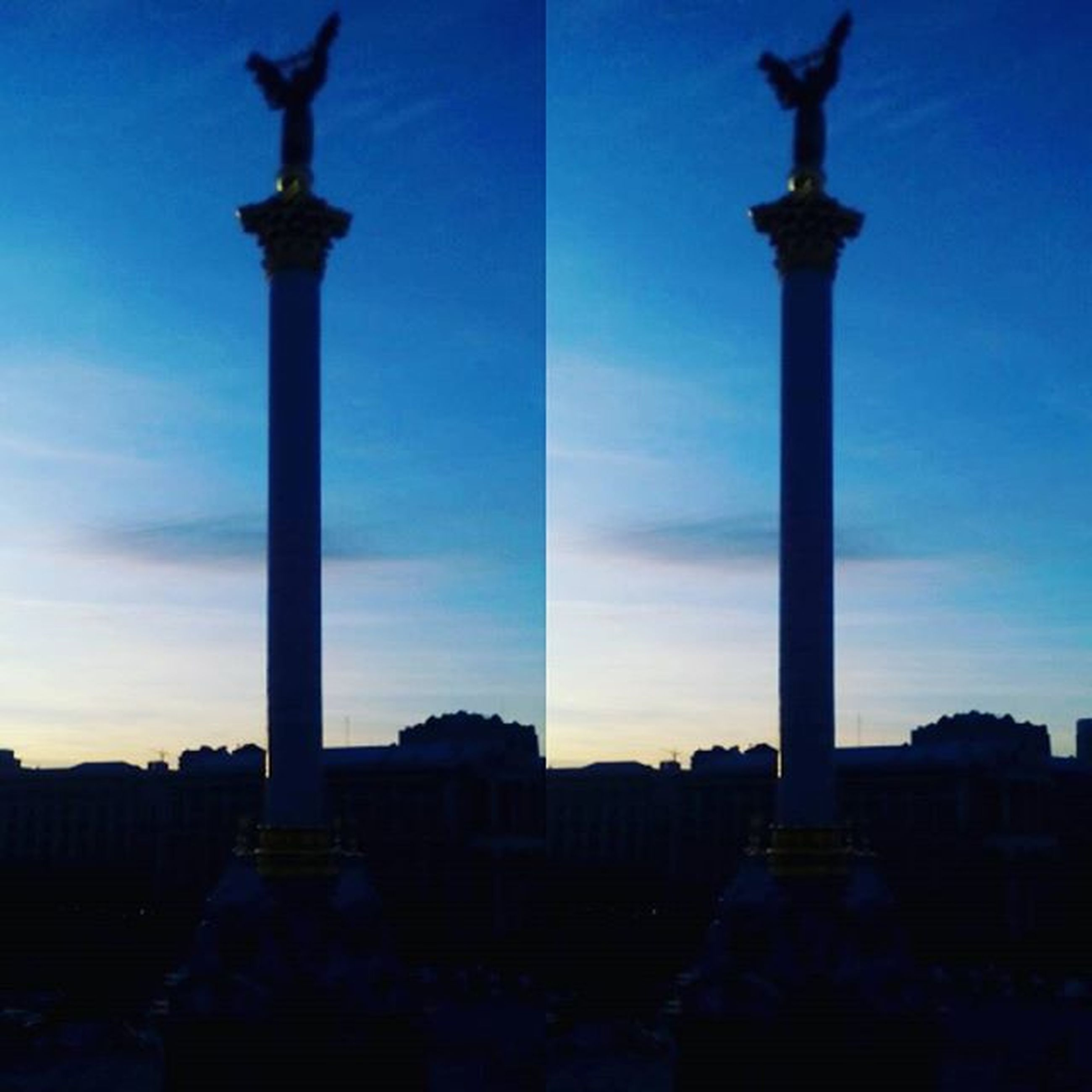 architecture, built structure, building exterior, silhouette, blue, low angle view, sky, religion, architectural column, dusk, place of worship, spirituality, history, street light, statue, column, famous place, cross, church