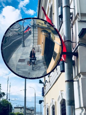 City Life Mirror Moscow Russia Bike Building Building Exterior Built Structure City Cycling Mirror Reflection Mode Of Transport Moscow Life Outdoors Real People Reflection Russian Flag Self Portrait Selfie Selfie ✌ Transportation Women