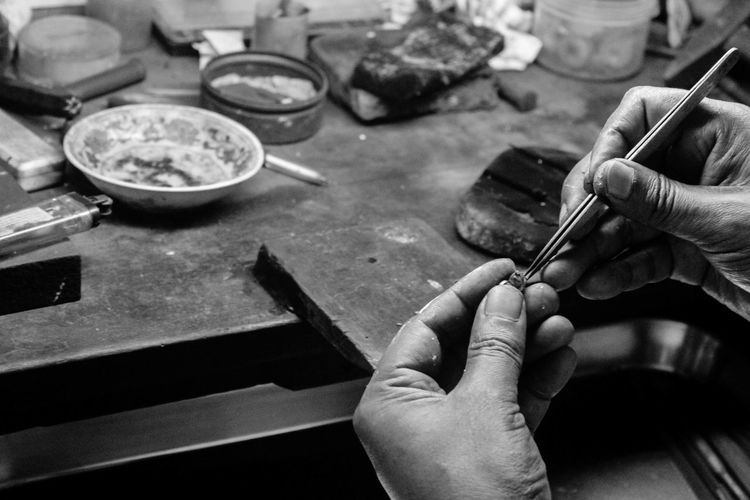 Cropped image of jeweller working in workshop