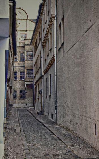 Narrow street amidst buildings in town