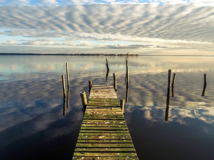 Pier in a lake Mecklenburg-Vorpommern Non-urban Scene Nature_collection Water Sky Cloud - Sky Nature Sea Wood - Material Beauty In Nature Scenics - Nature Pier Sunlight Tranquility Tranquil Scene Reflection Land Day Outdoors