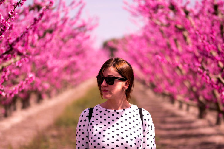 Portrait of woman with pink flower