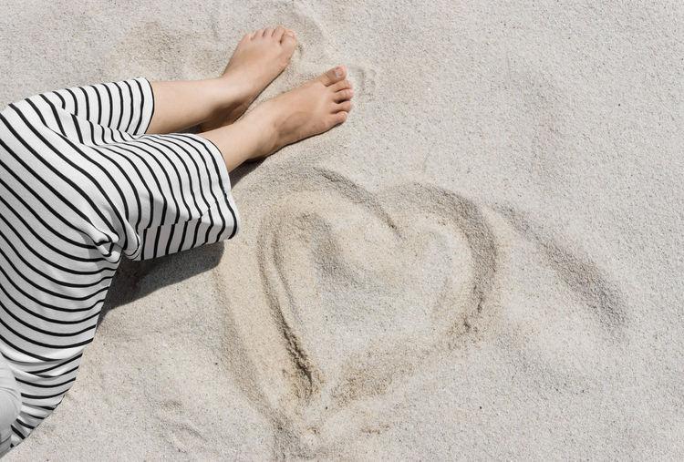 Woman Sitting On Beach