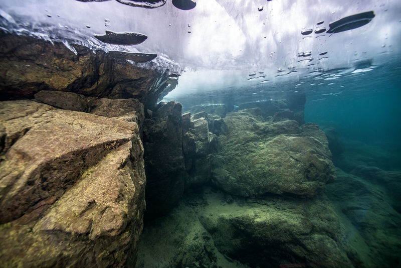 winter underwater Backgrounds Beauty In Nature Blue Close-up Day Full Frame Geology Idyllic Majestic Natural Pattern Nature No People Non-urban Scene Outdoors Physical Geography Remote Rock Rock - Object Rock Formation Rocky Scenics Sky Tranquil Scene Tranquility Water