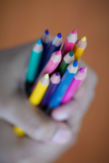 A children hand holding a bunch of colourful pencil Back To School Bestsellers Bunch Of Pencil Choice Close-up Day Education EyeEm Best Shots EyeEmBestPics Fingernail Human Body Part Human Hand Improvement Indoors  Love Multi Colored One Person One Woman Only Pencil Pencil Art Variation