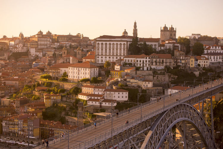 High angle view of dom luis i bridge against cityscape during sunset