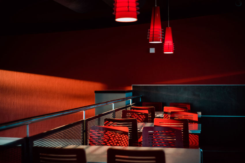 Red Absence Architecture Built Structure Chair Electric Lamp Empty High Angle View Illuminated In A Row Indoors  Light Light - Natural Phenomenon Lighting Equipment Night No People Railing Red Red Color Seat Stage Staircase Steps And Staircases Table