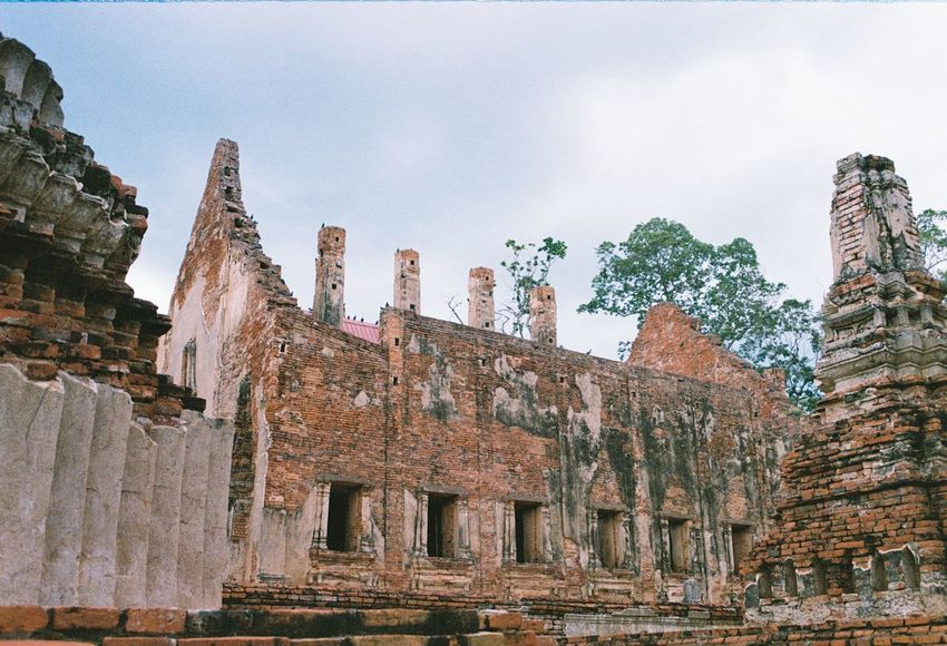 History Travel Destinations Religion No People Outdoors Architecture Day EyeEmNewHere Analog Life Thailand Old Buildings Old Architecture Filmphotography Eyemphotography Temple In Thailand Temple Phichit Best Of EyeEm Growth Feeling Travel Story Culture Cultivated Land EyeEm Selects