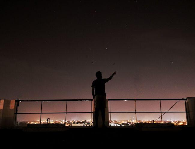 Aim for the stars Ravinchandra An Eye For Travel Reach Out Composition Stars Silhouette Night Sky Outdoors Prison One Person People Sunset Standing Adults Only Adult Nature One Man Only Only Men Politics And Government