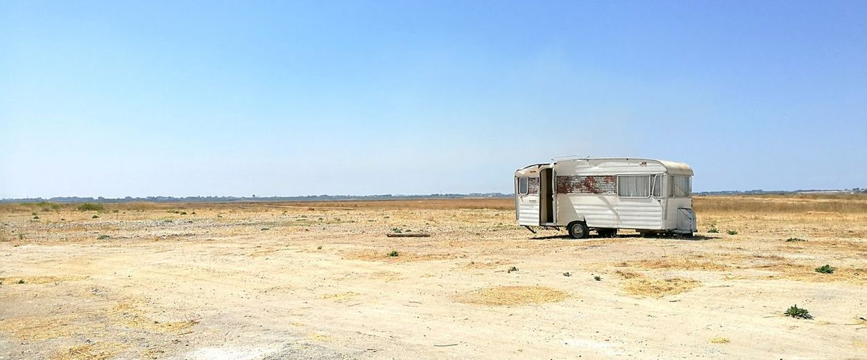 Abandoned Motor Home On Field Against Clear Sky