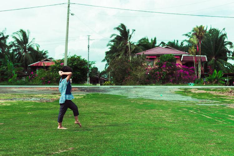 Full length of man on field against trees