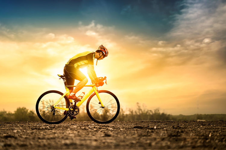 Bike at the summer sunset on the background of beautiful sunset Cloud Active Activity Adventure Bicycle Bicycles Bike Cycling Excercise Extreme Sports Health Healthy Helmet Lifestyles Men Nature Outdoors Riding Safety Sky Speed Sport Summer Sunrise Sunset