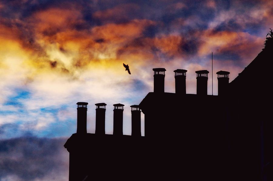 Silhouette Smoke Stack Building Exterior Built Structure Outdoors Chimney Architecture Sky No People Sunset Silhouettes Chimney Pots Beauty In Nature Silhouette