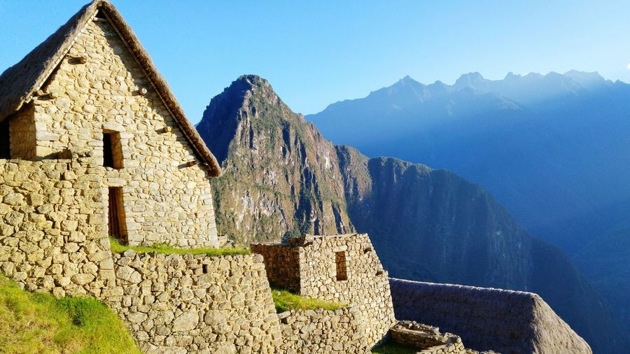 Machu Picchu at sunrise - Peru EyeEm Selects Mountain Outdoors Travel Destinations No People Blue Scenics Nature Sky Mountain Range Landscape Architecture Day Beauty In Nature Travel Beauty In Nature First Eyeem Photo Peru Nature Andes View Andes Mountains Machu Picchu - Peru MachuPicchu Inca