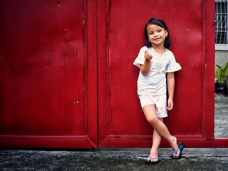 """Pula"" A picture of my daughter, when she requested for a quick snap. The red color of our house gate makes the picture more interesting. Hoohaa! EyeEmNewHere EyeEm Best Shots Fujifilm XT100 7artisans Randomphotos Composition Hobbyistphotographer Fuji Photographer Ndfiltered Lensculture Philippines Landscapephotography Streetphotographyworldwide Street_focus_on Streetsleaks Newbie Streetphotography Streets_storytelling Streetphotographycommunit Streetclassics DavaoCity Young Women Beautiful Woman Full Length City Beautiful People Wireless Technology Women Doorway"