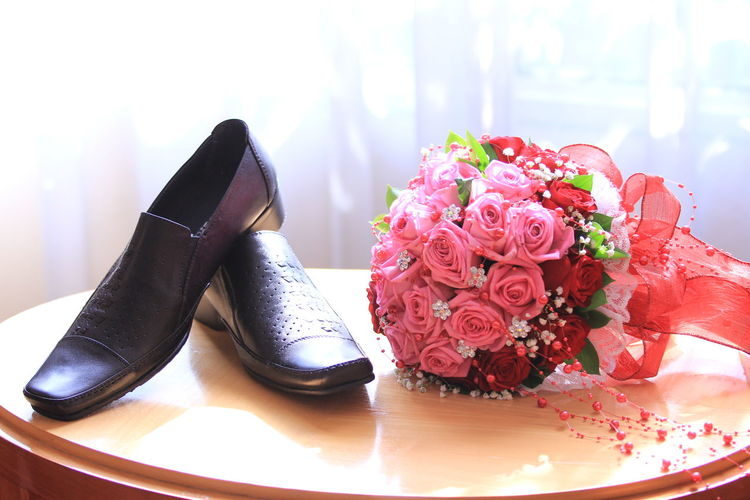 Shoes & Flowers Flower Flowering Plant Plant Beauty In Nature Rosé Wedding Table Rose - Flower Indoors  Close-up Shoe Celebration Still Life Event Life Events Bouquet Flower Head Flower Arrangement Wedding Ceremony Shoes