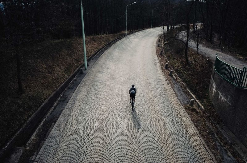 Adult Cobblestone Cycling Cyclinglife Day Full Length High Angle View Leisure Activity Lifestyles Men Nature One Person Outdoors People Real People Road Sports The Way Forward Walking