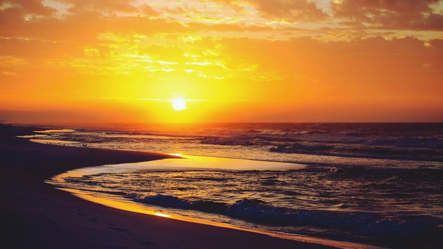 Sunset on the beach Sunset Sea Orange Color Beauty In Nature Sun Scenics Horizon Over Water Nature Water Sky Wave Beach Tranquil Scene Sunlight Tranquility No People Outdoors Silhouette Yellow