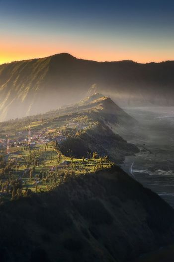 Aerial view of landscape against sky during sunrise at bromo mountain, indonesia