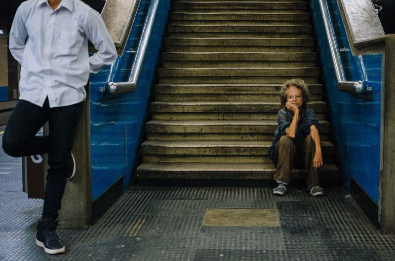 The Awaiting. Staircase Full Length Architecture Steps And Staircases Smiling Two People Looking At Camera People Emotion Women Casual Clothing Adult Front View Clothing Portrait Childhood Lifestyles Sitting Men Hairstyle EyeEm Best Shots EyeEm Selects Street Photography The Art Of Street Photography The Street Photographer - 2019 EyeEm Awards