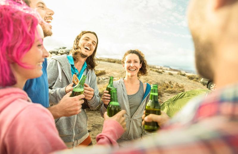 Friends enjoying beer outdoors