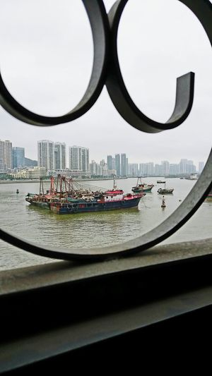 Boat Vessel Vessel In Port Sea Business Finance And Industry Macau Transportation Transport Picturesque Frame Picture Frame Circle No People City Cityscape Indoors  Eyeglasses  Skyscraper Close-up Day Architecture