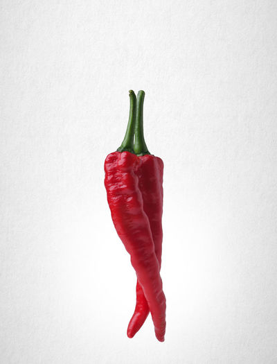 Red chili peppers against white background