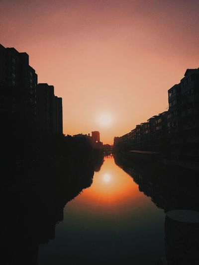 The beauty of life is still chasing perfection City Water Sunset Ancient Civilization Cityscape Urban Skyline Astronomy Red Reflection Ancient Standing Water Silhouette Reflection Lake Orange Color Calm