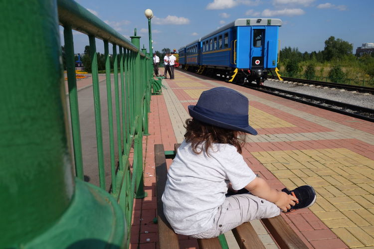 Day Sunny Day Bench Kid Train Train Station Waiting Boy Sky Rear View Hat Thinking Railway Station Platform Sombrero Wearing Sun Hat