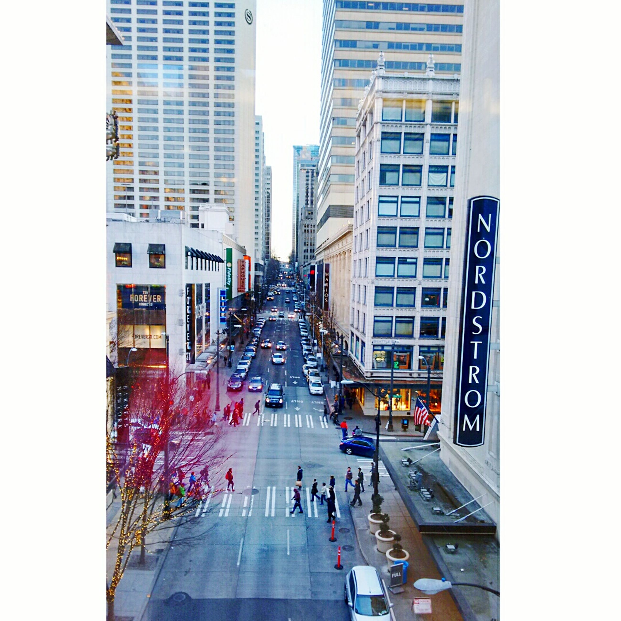 architecture, building exterior, built structure, city, city life, transportation, large group of people, street, men, city street, person, building, the way forward, walking, high angle view, lifestyles, land vehicle, car, skyscraper