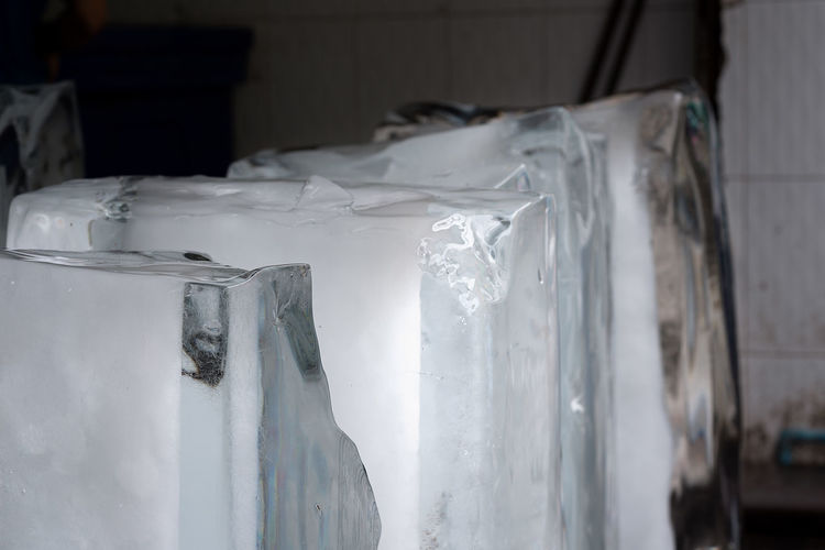 Large manufactured blocks of clear ice ready for distribution to food and restaurant outlets. A common method all over Asia. Clear Sky Distribution Frozen Ice Blocks Of Ice Collection Ice Blocks Ice Cold Ice Cubes Produced Thawing Thawing Ice