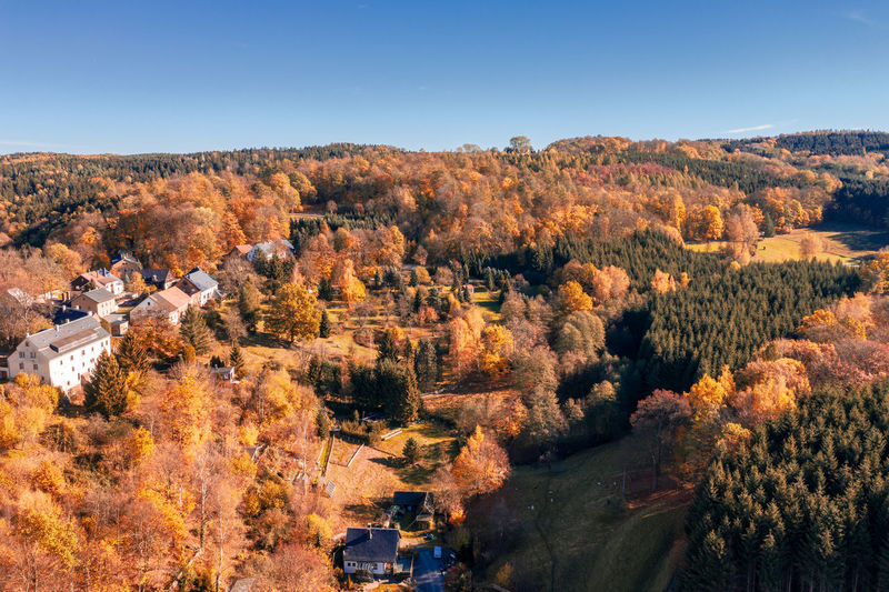 High angle view of autumn trees against sky