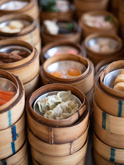 yumcha, dim sum in bamboo steamer, chinese cuisine DIM Sum Chinese Food Bamboo Dumpling  Hong Kong Restaurant Cuisine Steamed  Steamer China Dumplings Asian  Basket Steam Meal Traditional Dinner Dish Fresh Background Gourmet Meat Pork Lunch View Dimsum ASIA Snack Appetizer Top Delicious Bun Cantonese Shrimp Breakfast Yum Container